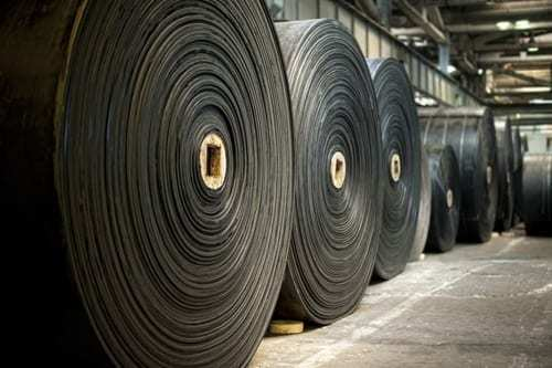 Rolls of EPDM rubber roofing material in a warehouse