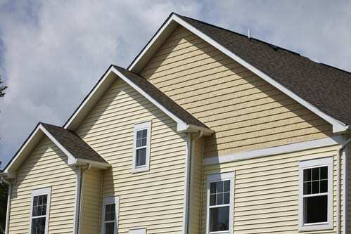Residential house with cream siding