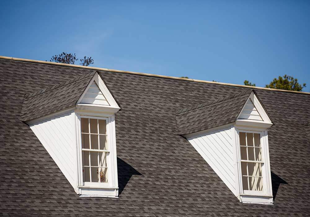 Two-White-Dormers-on-Gray-Shingle-Roof