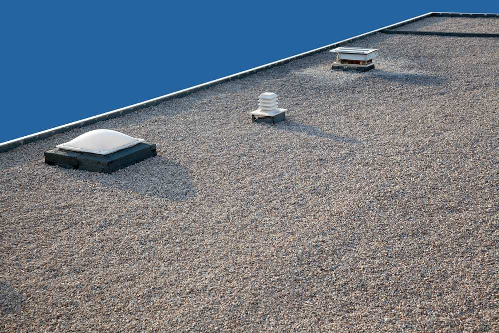 Gravel Commercial Roof with Skylight, Close-up