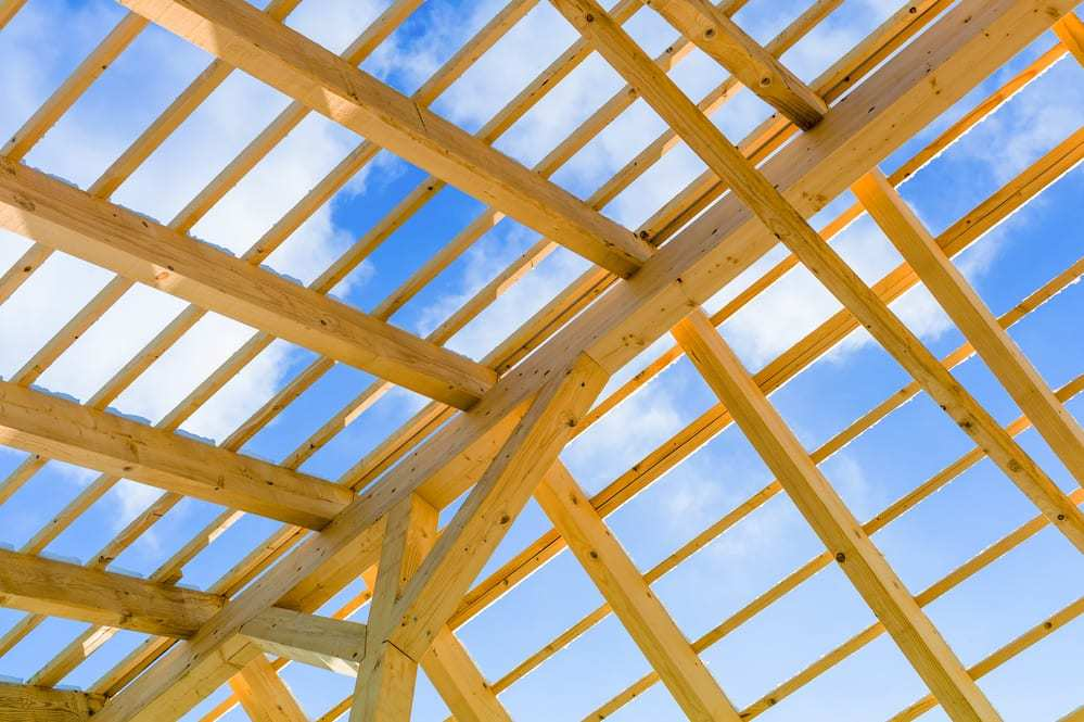 Wooden roof construction, blue sky