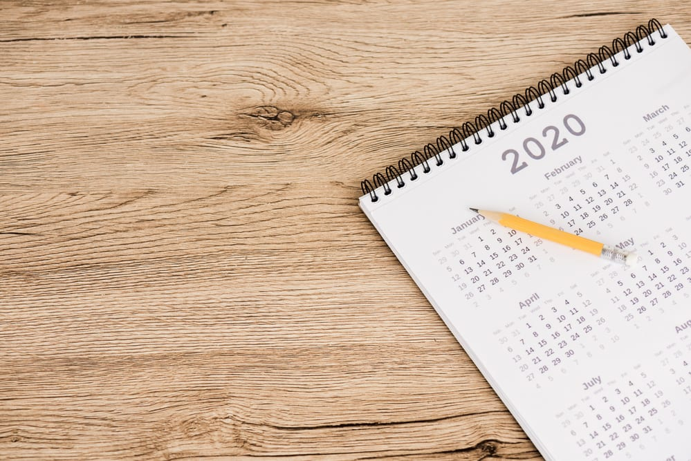 2020 calendar with pencil sitting on wood surface