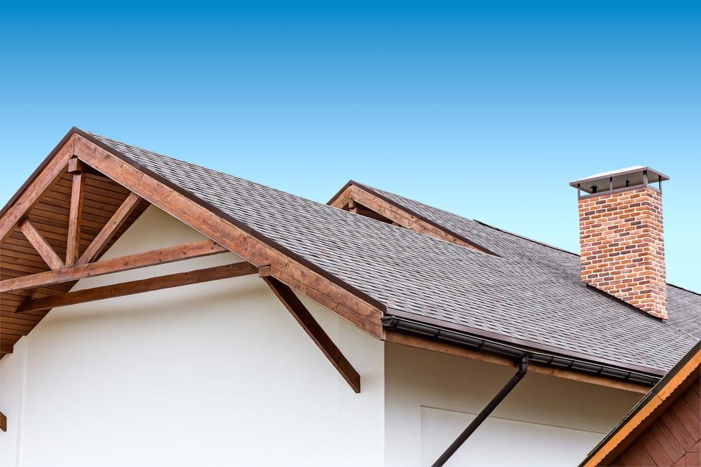 Roof with brick chimney, shows pitch of roof