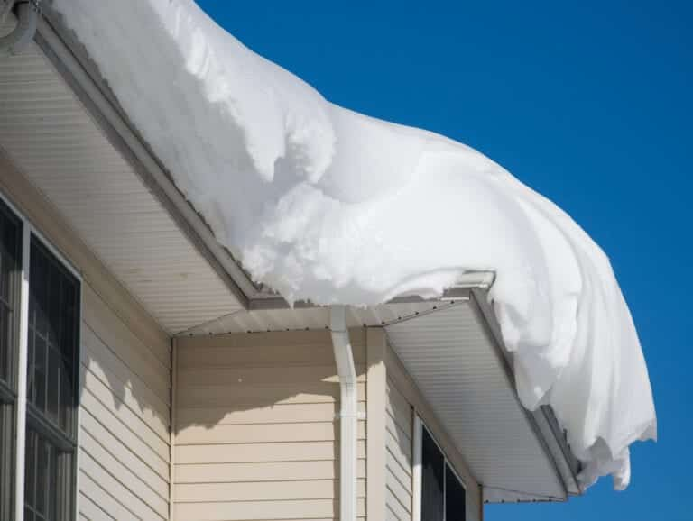 Close-up of heavy snow on roof