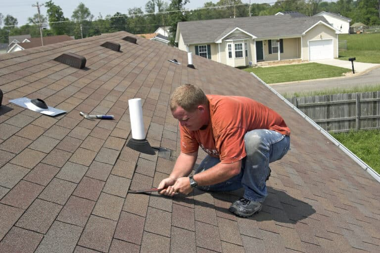 Roofer working on residential home roof